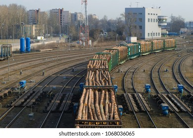ST. PETERSBURG, RUSSIA - APRIL 09, 2018: Railway cars loaded with the  timber on railway tracks of the sorting station