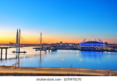 St. Petersburg, Russia - April 13, 2018: The cable-stayed bridge is the western high-speed diameter, and football stadium Zenit Arena at sunset.