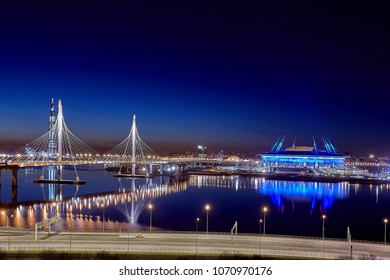 St. Petersburg, Russia - April 13, 2018: Cable-stayed bridge in western high-speed diameter, and soccer stadium Zenit Arena at dusk.