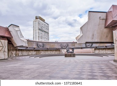 """ST. PETERSBURG, RUSSIA - APRIL 13, 2019: Photo of Concrete ring with a diameter of open, symbolizing the breakthrough of the blockade, and the sculptural group """"Blockade""""."""