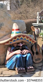 St. Petersburg, Russia. April 14, 2018. A figure of a sleeping Mexican in  sombrero with guitar at amusement park.