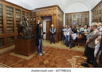 ST. PETERSBURG, RUSSIA - APRIL 20, 2018: People in the depository of personal library of French Enlightenment writer Voltaire in the National Library of Russia during Library Night