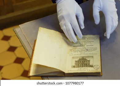 ST. PETERSBURG, RUSSIA - APRIL 20, 2018: Guide demonstrate the book from Rossica collection in the book depository of the National Library of Russia during Library Night