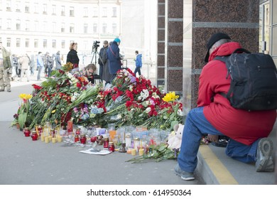 St. Petersburg, Russia - April 4, 2017. Residents of the city of St. Petersburg are carrying flowers to the metro station Sennaya Ploshchad, where on April 3, a terrorist exploded a bomb.
