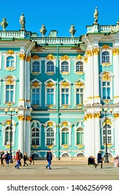 St Petersburg, Russia - April 5, 2019. State Hermitage Museum facade and tourists walking at the Palace Square. Winter palace and its precincts form the Hermitage Museum. City landscape
