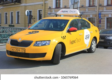 ST. PETERSBURG, RUSSIA - APRIL 9, 2018: Yandex Taxi Yellow Car on City Street. Yandex Taxi is Russia's Largest Online Taxi Booking Services Used by Approximately 200 Russian Taxi Companies.