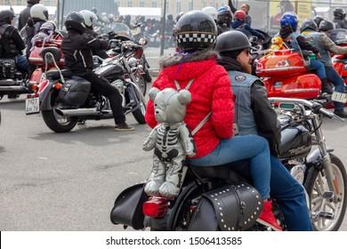 St. Petersburg, Russia - August 03,  2019: Harley-Davidson Motorcycle Festival in St. Petersburg. brutal bikers on motorcycles. zombie bear backpack