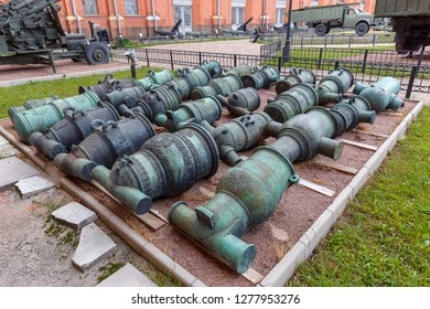St. Petersburg, Russia - August 11, 2018: Barrels of old artillery pieces are laid on the site at the Museum of Artillery