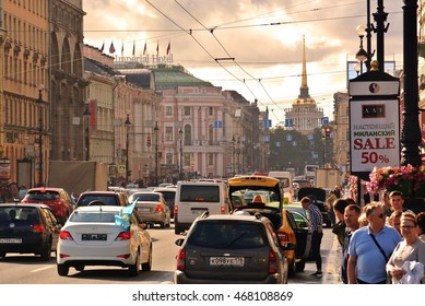 ST. PETERSBURG, RUSSIA - August 2, 2016: Nevsky prospect, typical street scene with cars and people walking along the avenue  in Saint Petersburg, Russia