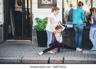 ST PETERSBURG, RUSSIA - AUGUST 21, 2016: Beautiful Child Girl Dancing on the Street