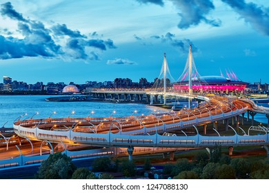 St. Petersburg, Russia - August 22, 2018: cable-stayed bridge over the river Neva in the twilight, the stadium Zenith Arena is located nearby.