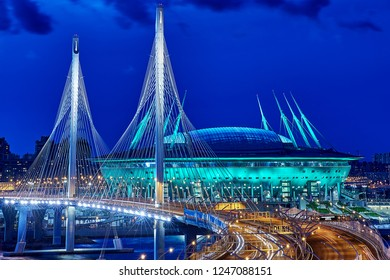 St. Petersburg, Russia - August 22, 2018: new cabletrussbridge and Saint Petersburg Arena, lit by night lights.