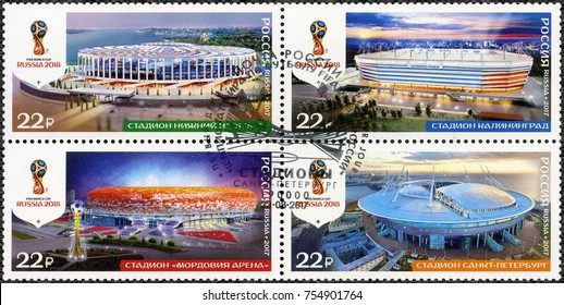 ST. PETERSBURG, RUSSIA - AUGUST 23, 2017: A stamp printed in Russia shows stadiums in Kaliningrad, Nizhny Novgorod, St Petersburg and Saransk, series Stadiums, 2018 Football World Cup Russia, 2017