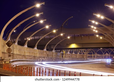 St. Petersburg, Russia - August 24, 2018: Saint Petersburg's illuminated expressway with highway sound proof barrier panel and flexible bollard to separate the road from the worksite.