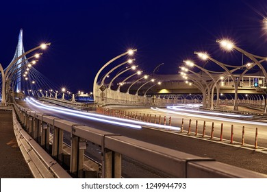 St. Petersburg, Russia - August 24, 2018: Night view of Saint Petersburg's freeway with steel barrier and road cones for traffic control.