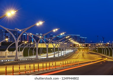 St. Petersburg, Russia - August 24, 2018: Illuminated western high-speed diameter with residential buildings on the background in Saint Petersburg.