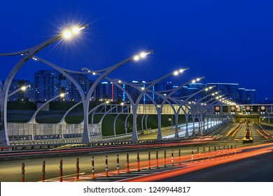 St. Petersburg, Russia - August 24, 2018: Saint Peterburg's highway with soundproof and safety barrier in light tracks at night.