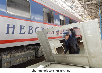 ST. PETERSBURG, RUSSIA - AUGUST 25, 2016: Worker in the new industrial building of Oktyabrsky electric railway car repair plant. Founded in 1826, now the plant not only repair but also build cars