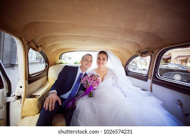 St Petersburg, Russia - August 27, 2017: Wedding Event. Wedding Couple Bride and Groom on a Wedding Walk in Weddin Car