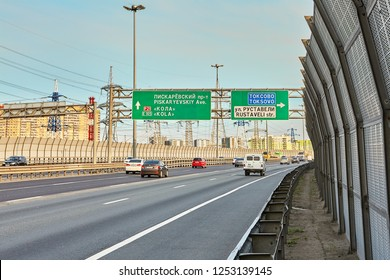 St. Petersburg, Russia - August 28, 2018: several cars drive along the ring road with highway sound proof barrier panel and traffic barrier.