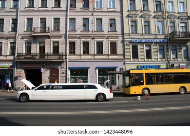 St. Petersburg, Russia - August 28th 2011: A white stretch limousine with - due to an embarrassing break-down -open trunk and cowl on the streets of St. Petersburg, Russia