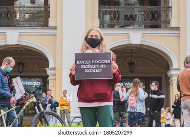 "St Petersburg, Russia - August 29, 2020: a protester holds a poster ""When will Russia come out of a coma?"" at a rally at Gostiny Dvor. References to poisoning of Navalny & Russia's political inertia."