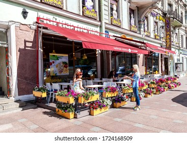 """St Petersburg, Russia - August 5, 2015: Traditional summer outdoor street cafe """"Tea spoon"""" in summer sunny day"""
