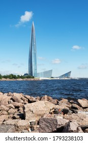 St. Petersburg, Russia - AUGUST 7, 2020: The rocky shore of the Baltic sea and the Lakhta center tower in the Primorsky district of Saint Petersburg.