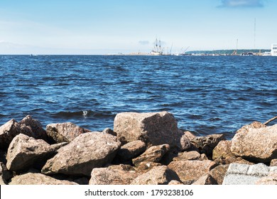 St. Petersburg, Russia - AUGUST 7, 2020: The rocky shore of the Baltic sea and a view of the port of the Primorsky district of Saint Petersburg.