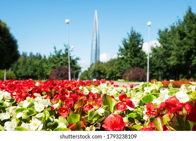 St. Petersburg, Russia - AUGUST 7, 2020: Park road with flowerbeds and a view of the Lakhta center in the Primorsky district of Saint Petersburg.