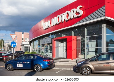ST. PETERSBURG, RUSSIA - CIRCA AUG, 2016: Exterior of building of car dealership with new vehicles standing next to doors. The Avtomir is a official dealer of Kia motors company