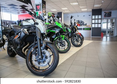 ST. PETERSBURG, RUSSIA - CIRCA FEB, 2017: New naked motorcycles ER-6 and ER-6F of Kawasaki brand is on sale in motorcycle shop. Official dealership of Kawasaki, Ducati and Arctic Cat is in city