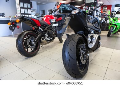 ST. PETERSBURG, RUSSIA - CIRCA FEB, 2017: Contemporary street or naked motorbikes stand in showroom on sale. Official dealership of Kawasaki, Ducati and Arctic Cat is in city of Saint-Petersburg