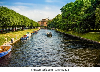 St. Petersburg, Russia - CIRCA June 2013: Rivers and canals. People travel on ships. For them arranged tours of the city and they can see different view.