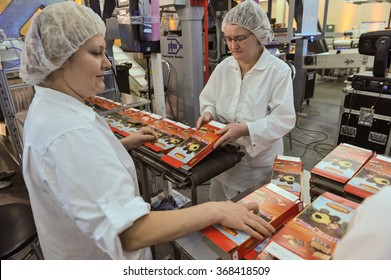 St. Petersburg, Russia - December 14, 2015: Workers on the production line for the production of wafer cakes. Plant for the production of confectionery products.
