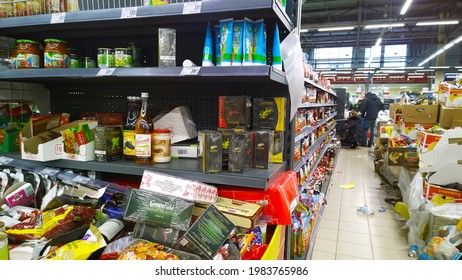 St. Petersburg, Russia - December, 2019: Pile of dirty cardboard boxes with food and products. Clutter, trash and scattered goods. Messy shelves. Supermarket waste. Grocery Store. Retail industry.