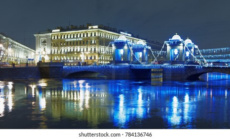 ST. PETERSBURG, RUSSIA - DECEMBER 24, 2017: Lomonosov bridge across Fontanka river decorated for Christmas. Built between 1785 and 1787, it is the best preserved of towered movable bridges