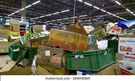 St. Petersburg, Russia - December 29, 2019: Bankruptcy and liquidation of supermarket. Retail industry. Huge pile of cardboard boxes with food on dirty floor in store. Messy. Consumer Behavior.