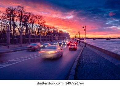 St. Petersburg. Russia. Embankment at the Summer Garden. Cars rush past the Summer garden. Colorful Petersburg sunset. Neva River. Petersburg views. Streets of St. Petersburg.