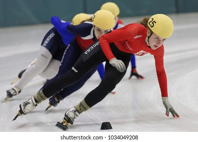 ST. PETERSBURG, RUSSIA - FEBRUARY 16, 2018: Female athletes compete in short track speed skating during Pavlovsky Cup. Athletes from 6 countries participated in the competitions