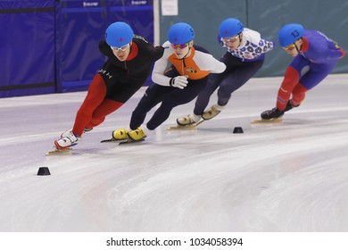 ST. PETERSBURG, RUSSIA - FEBRUARY 18, 2018: Olympic champion Vladimir Grigoriev (in front) in short track speed skating competitions during Pavlovsky Cup. Athletes from 6 countries participated