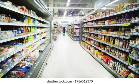 St. Petersburg, Russia - February 3, 2021: Top Russian Supermarket is one of largest players of retail industry in Russia. Shelves with products. Rack with fresh food. Mart. Aisle. Grocery store.