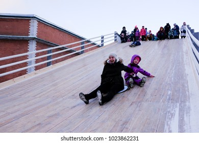 St. Petersburg, Russia - February 7, 2018: People ride from a high specially equipped ice slide during the celebration of the birth of Christ.