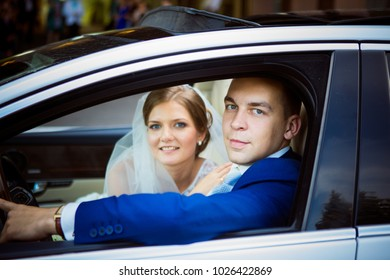 St Petersburg, Russia - July 03, 2017: Wedding Event. Wedding Couple Bride and Groom on a Wedding Walk in Wedding Car