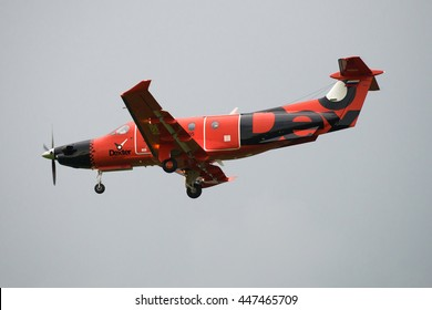 """ST. PETERSBURG, RUSSIA - JULY 03, 2016: Aircraft Pilatus PC-12/47E (RA-01505) Russian air taxi """"Dexter"""" on the background of cloudy sky"""