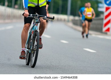 St. Petersburg, Russia - July 06, 2017: City marathon. Group of athletes and cyclists.  The concept of a healthy lifestyle