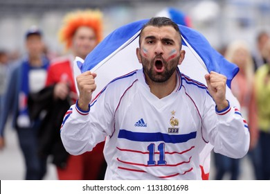ST. PETERSBURG, RUSSIA - JULY 10, 2018: French football fans singing at Saint-Petersburg stadium before the semifinal match of FIFA World Cup Russia 2018 France vs Belgium. France won 1-0
