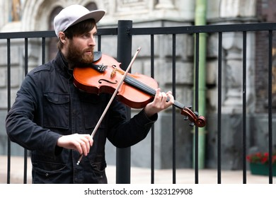 St. Petersburg, Russia - July 13, 2017: Violin, viola. A young guy plays the violin on a city street.