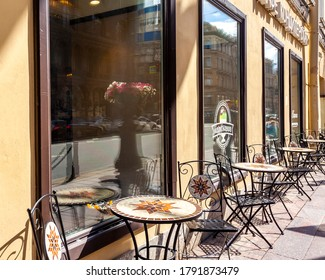 St. Petersburg, Russia, July 13, 2020. The architectural ensemble of Nevsky Prospekt, the main street of the city. Sidewalk cafe tables