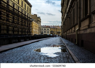 ST. PETERSBURG, RUSSIA - JULY 13, 2016: Old town pavement street on rainy day.